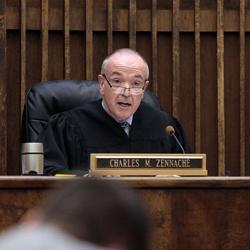 Lane County Circuit Judge Charles Zennache reads the jury verdicts